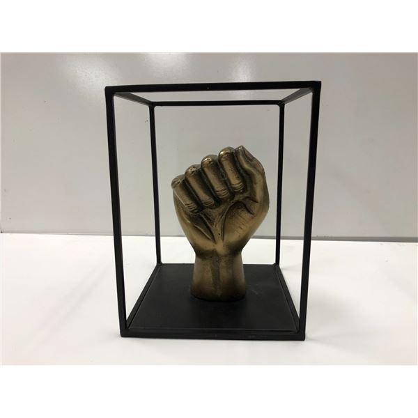 Metal fist decorative art sculpture approx. 10in tall x 7in wide