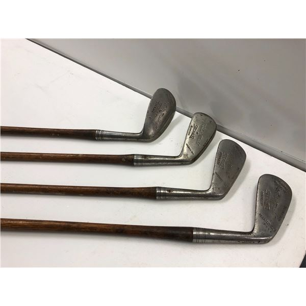 """Group of 4 early 1900's """"Tailor Made"""" by Shaler wood handled golf clubs - matched set"""