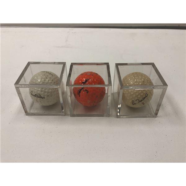 Group of 3 encased vintage golf balls - Arnold Palmer #1/ Lee Trevino #2/ Johnny Miller #3
