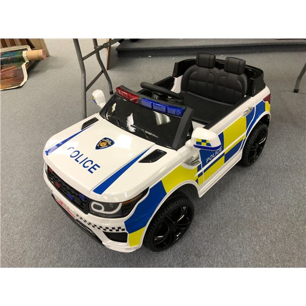 Child's motorized electric ride-in Police cruizer w/ lights & stereo