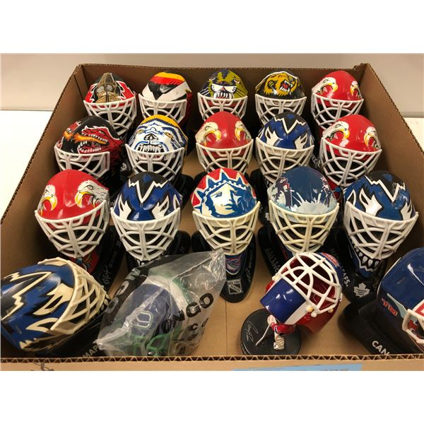 Box of NHL collectible small team goalie helmets