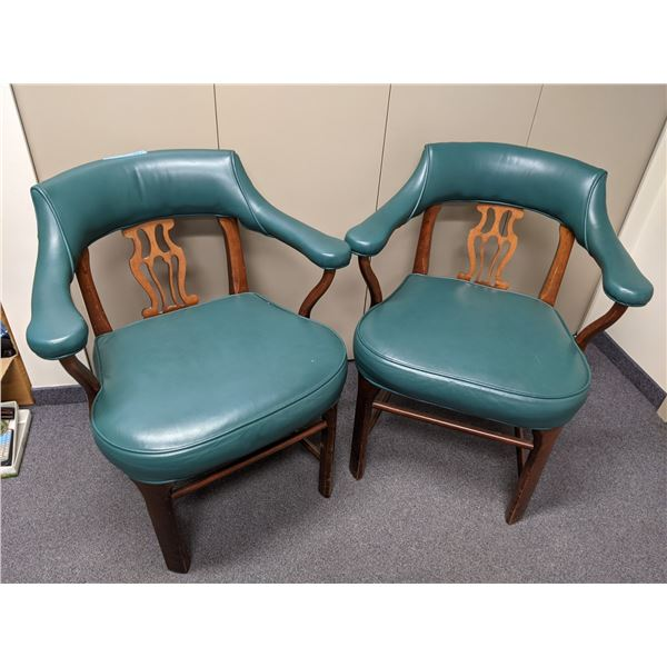 Pair of turquoise vinyl upholstered club chairs