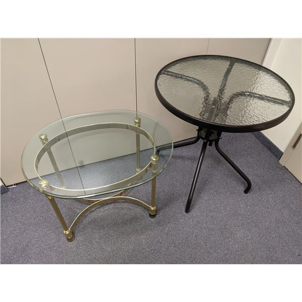 Two small tables - small round glass top patio table & heavy brass glass top end table