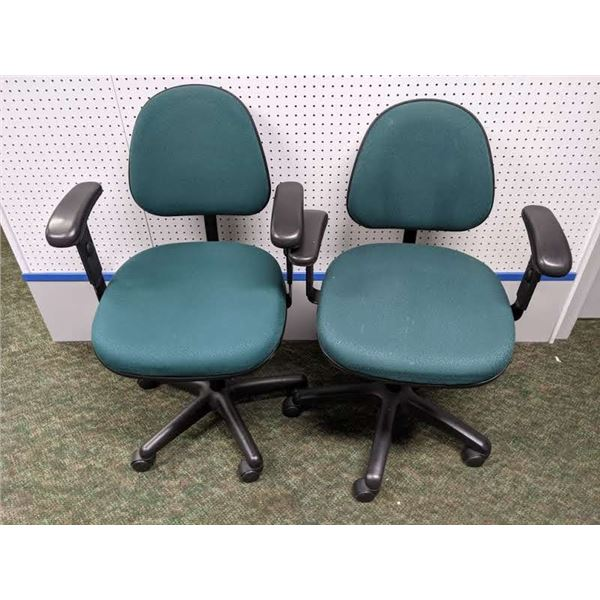 Pair of green upholstered office chairs