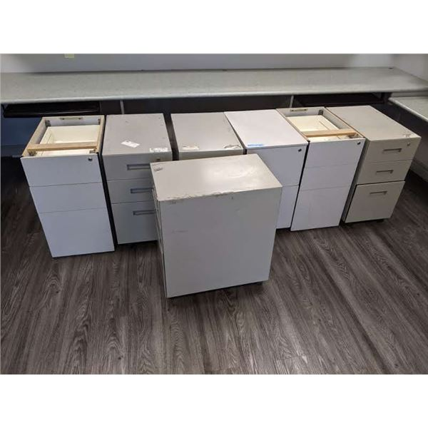 Group of 7 small filing cabinets