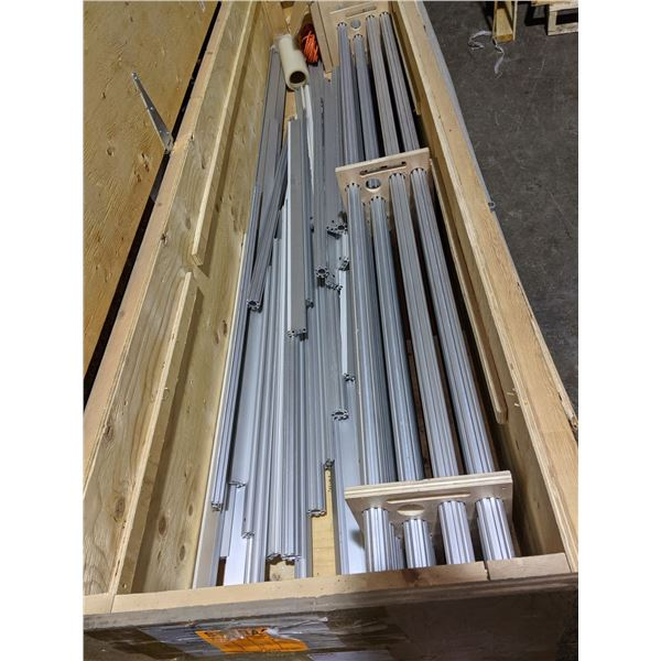 Approx. 2 1/2ft x 11ft wooden rolling storage crate w/ aluminum extrusions fabricating jam material