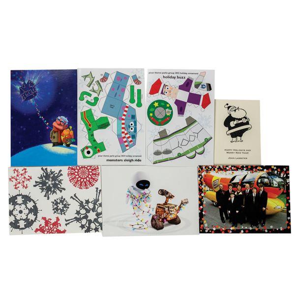 Set of (6) Pixar and (2) John Lasseter Christmas Cards.