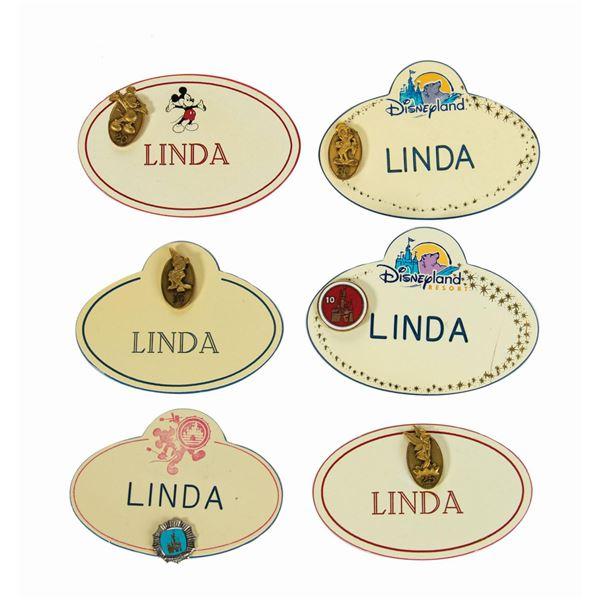 """Set of (18) """"Linda"""" Cast Member Nametags."""