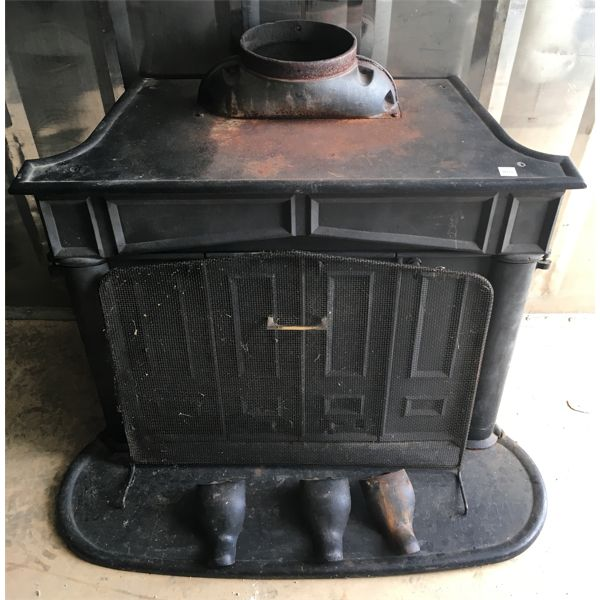 CAST WOOD STOVE W/ FIREPLACE TOOLS - 16 X 28 X34 INCHES