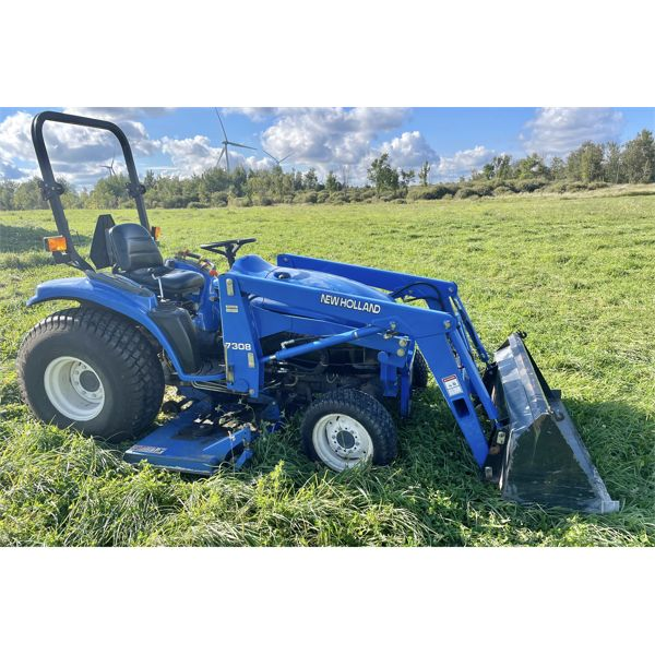 NEW HOLLAND MODEL TC33D 4WD TRACTOR WITH 7308 LOADER
