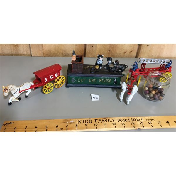 TOY LOT - CAST MECHANICAL BANK, FIRE & ICE TRUCKS, QTY OF CLAY MARBLES