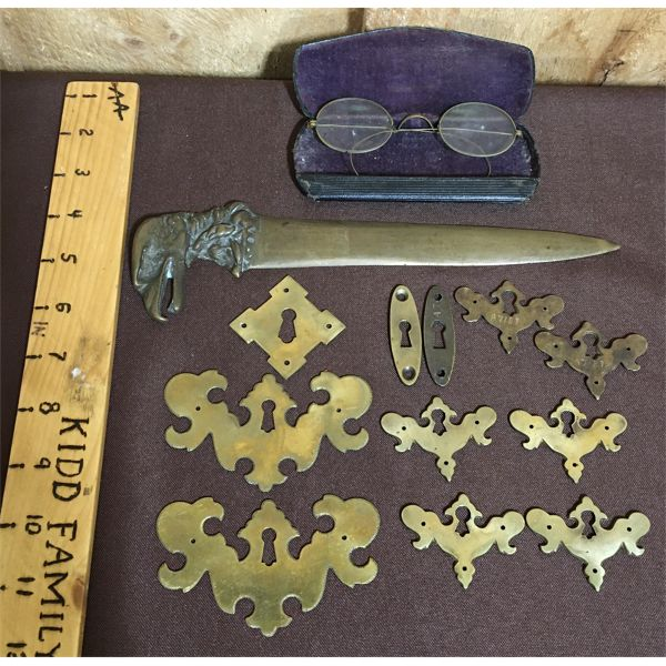 LOT OF BRASS ESCUTCHEONS, SPECTACLES AND LETTER OPENER