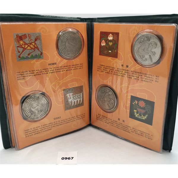CHINESE REFERENCE BOOK WITH 12 HISTORICAL COINS - DENOTED BY THE 'YEAR OF SYMBOLS'