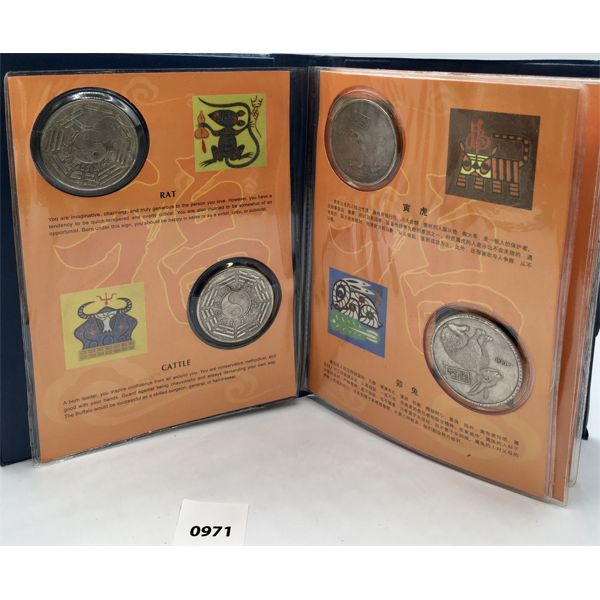CHINESE REFERENCE BOOK WITH 12 HISTORICAL COINS - DENOTING THE 'YEAR OF' SYMBOLS