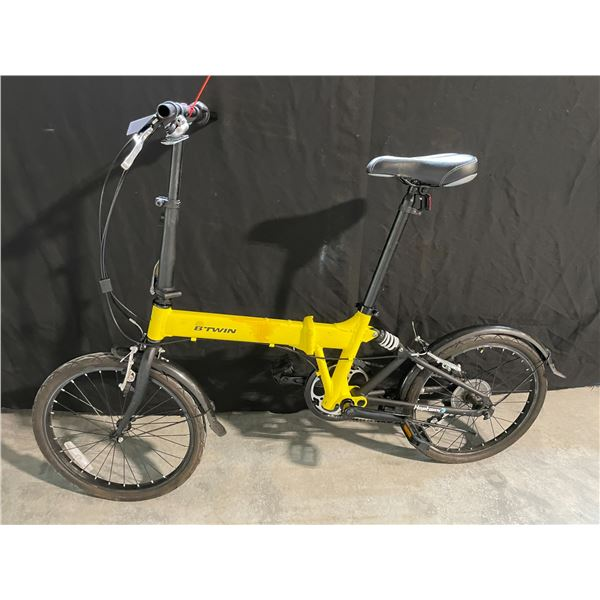 YELLOW BTWIN HOPTOWN 3, 6 SPEED FOLDING BIKE WITH REAR SHOCK ( MISSING HANDLE GRIPS )