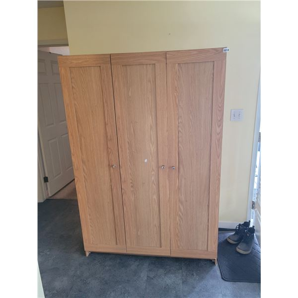 Storage Cabinet with various cleaning supplies