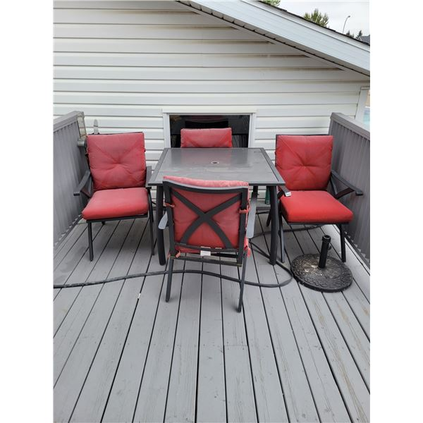 Glasstop Patio Set. 4 Chairs and Umbrella Stand