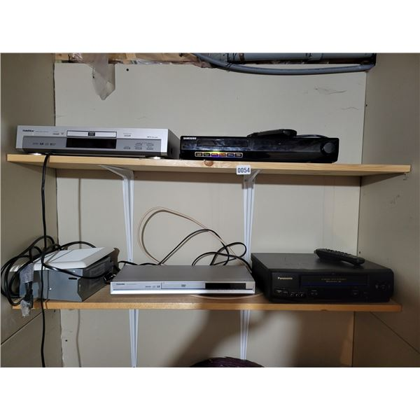 3 DVD Players and a VHS Player