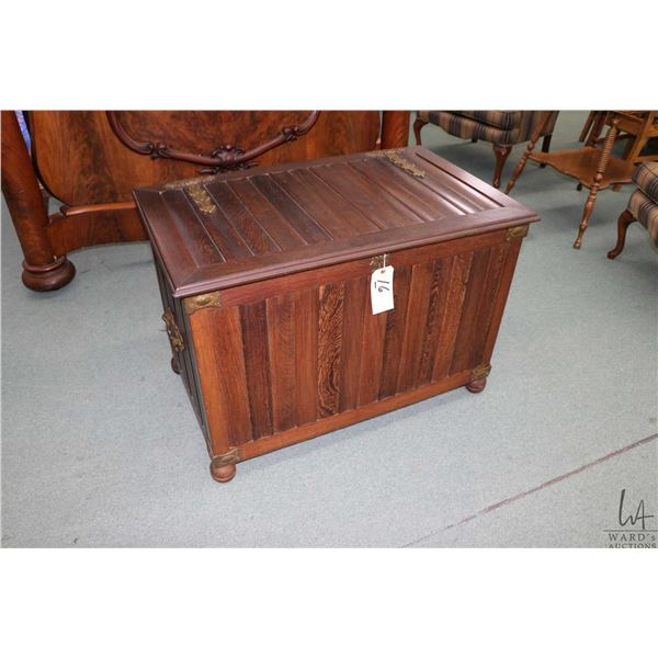 Antique tudor style oak lift lid chest with simulated hand hammered hardware and bun feet, note lock