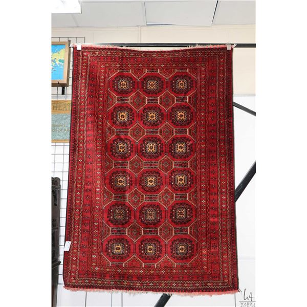 100% handmade Iranian Turkamann wool area carpet with overall geometric design, red background and m