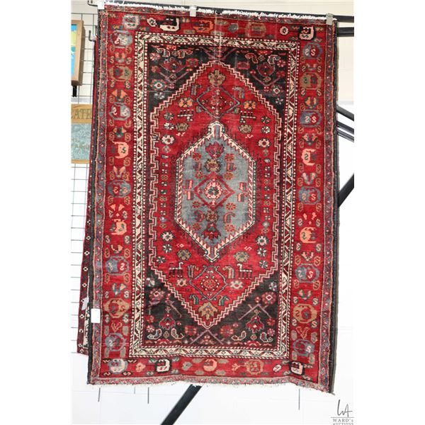 100% handmade Iranian Zanjan wool area carpet with center medallion, red background and highlights o