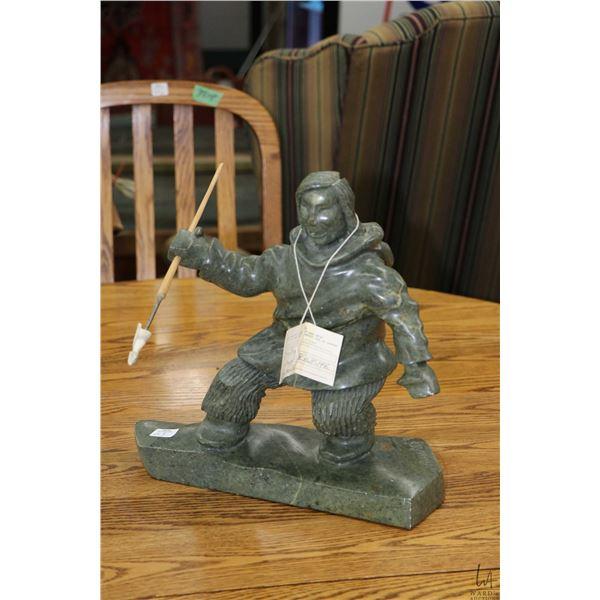 "Hand carved soapstone figure ""The Hunter"" with Inuit tag indicating artist Amiraq, Tuktoyaktuk NWT 1"