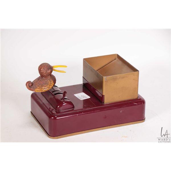 Vintage American made tin bird motif cigarette dispenser