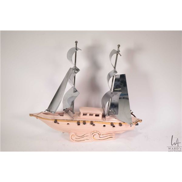 """Pottery sailboat motif accent lamp, 16"""" in length and working at time of cataloguing"""