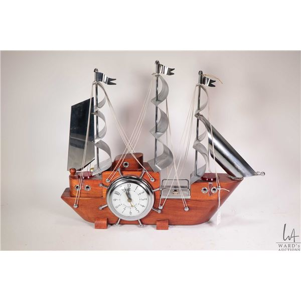 Tall ship motif mantle clock with accent lights made by Sessions USA, working at time of cataloguing