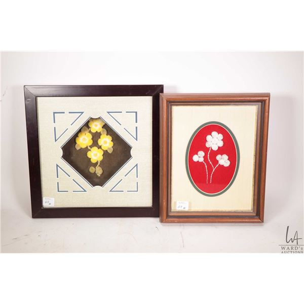 """Two framed moose tuftings including 11 1/4"""" X 11 1/4"""" shadowbox with yellow flowers and a 10 3/4"""" X"""