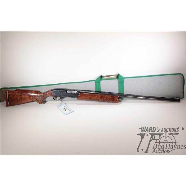 "Non-Restricted shotgun Remington model 1100 Trap, 12Ga 2 3/4"" semi automatic, w/ bbl length 30"" [Blu"