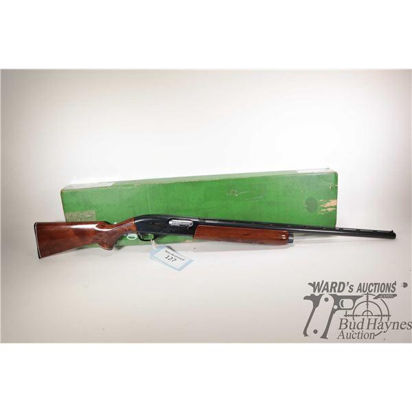 "Non-Restricted shotgun Remington model 1100, 12Ga 2 3/4"" semi automatic, w/ bbl length 25 3/4"" [Blue"