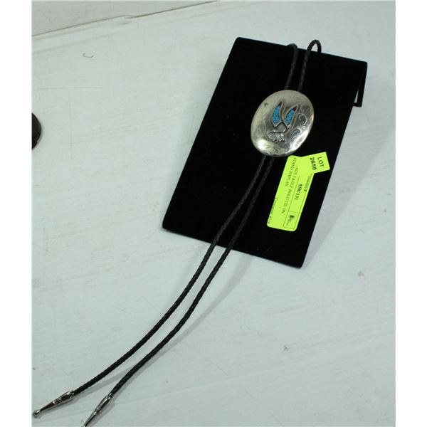 VINTAGE EAGLE BOLO TIE ON STAND DISPLAY