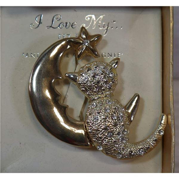 GOLD TONE AND RHINESTONE CAT WITH MOON BROOCH