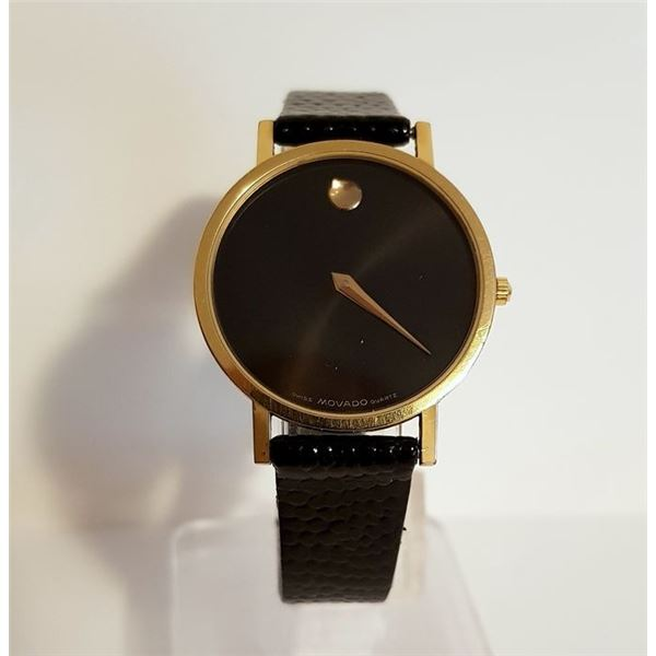 SWISS MOVADO GOLD PLATED 30MM BLACK DIAL WATCH.