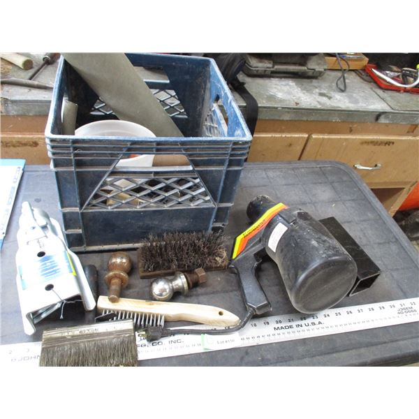 plastic crate with paint gun, brushes, trailer coupler, ball hitches