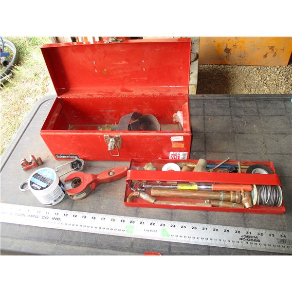 Metal tool box with soldering related tools