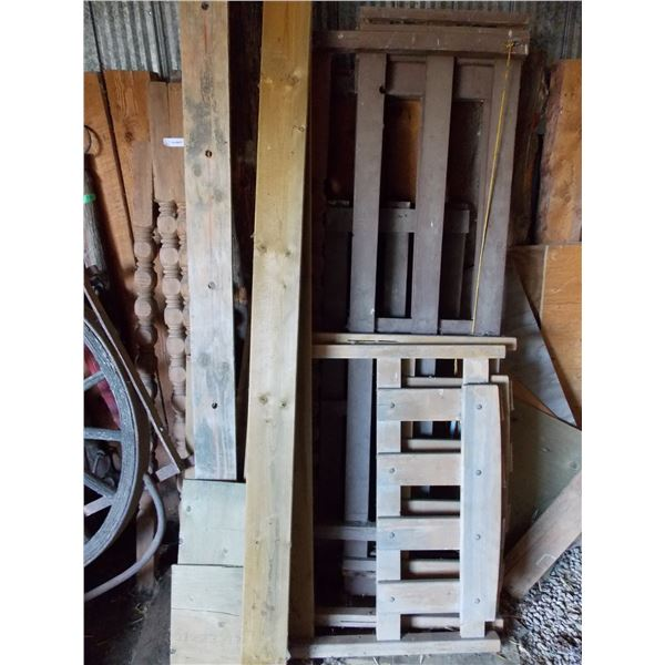 assorted lumber pieces and wooden spindles