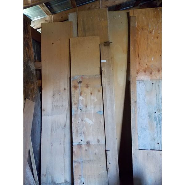 assorted lumber pieces and plywood