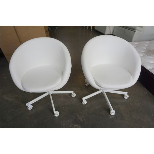 2 WHITE ROLLING LEATHER LOOK BUCKET CHAIRS