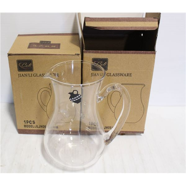 PAIR OF TWO GLASS PITCHERS