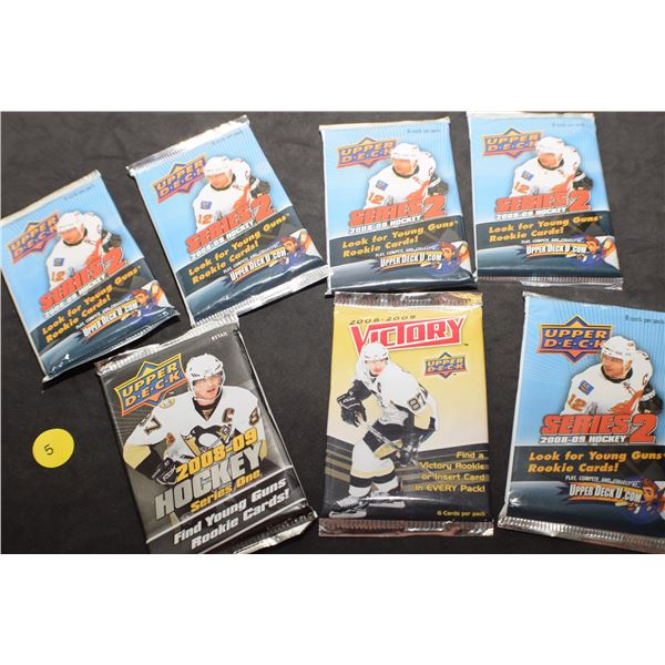 7 packs of sealed Hockey cards