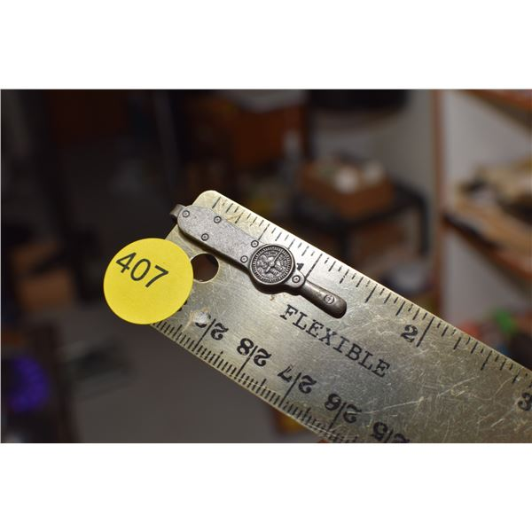 Antique torque wrench tie clip