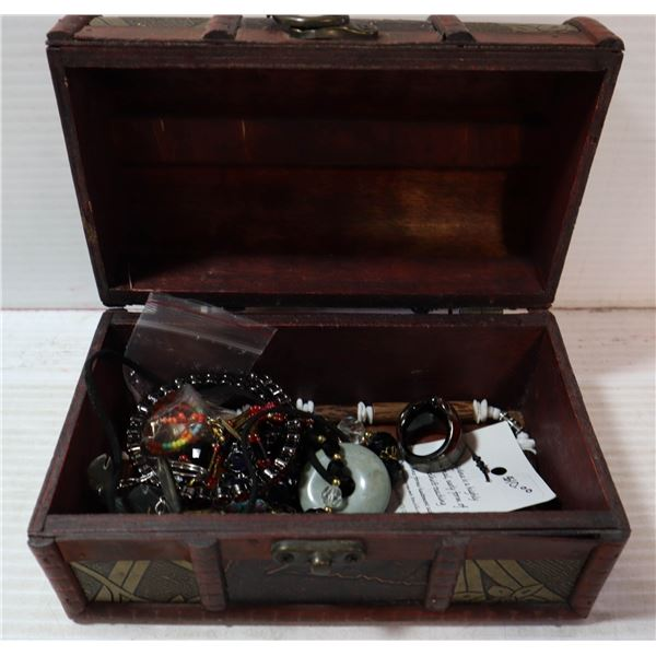 SMALL CHEST FILLED WITH COSTUME JEWELLERY