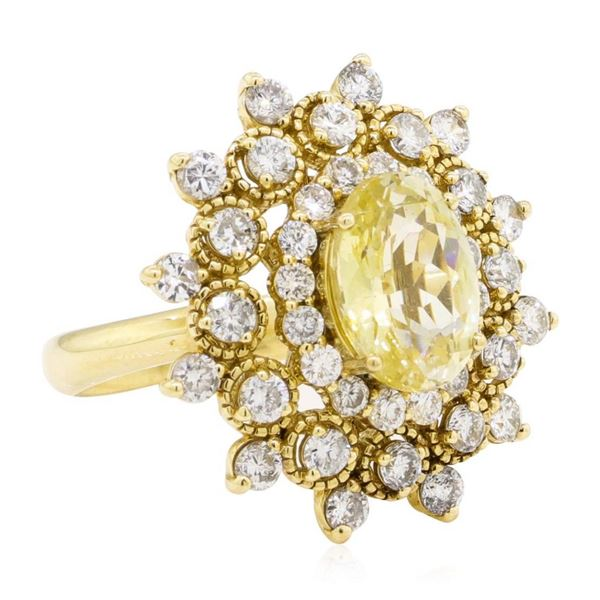 6.09 ctw Oval Mixed Yellow Sapphire And Round Brilliant Cut Diamond Ring - 14KT