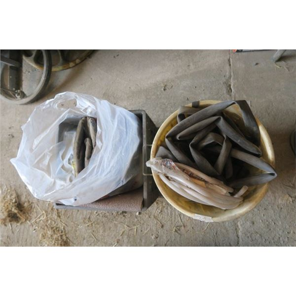 Crate of Gloves and Garbage Can of Bike Tire Tubes
