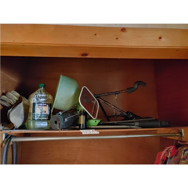 Shelf Contents Including Welding Gloves, Mole Trap, and Hedge Trimmer