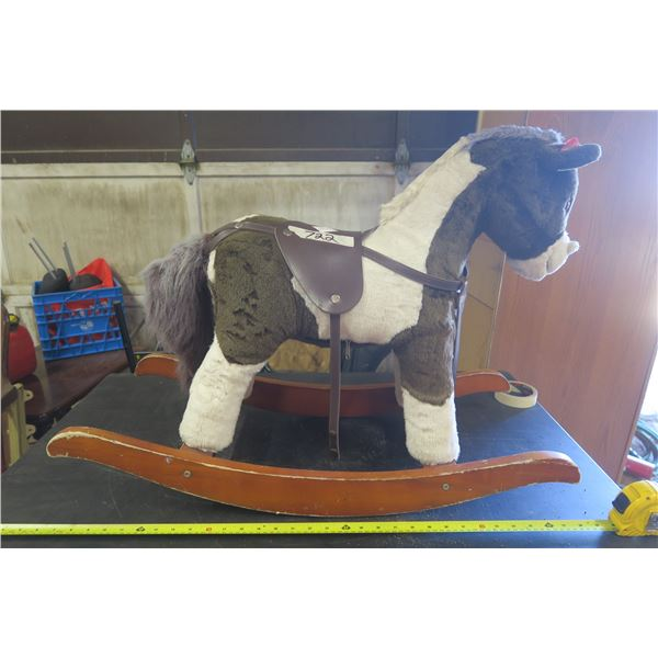 """Rocking Horse Aprox. 30"""" Long Whinneys and Gallops When you Squeeze Its Ear"""