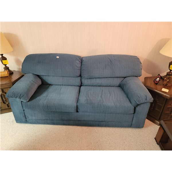 Teal Sofa Bed with Small Table & Artificial Flowers