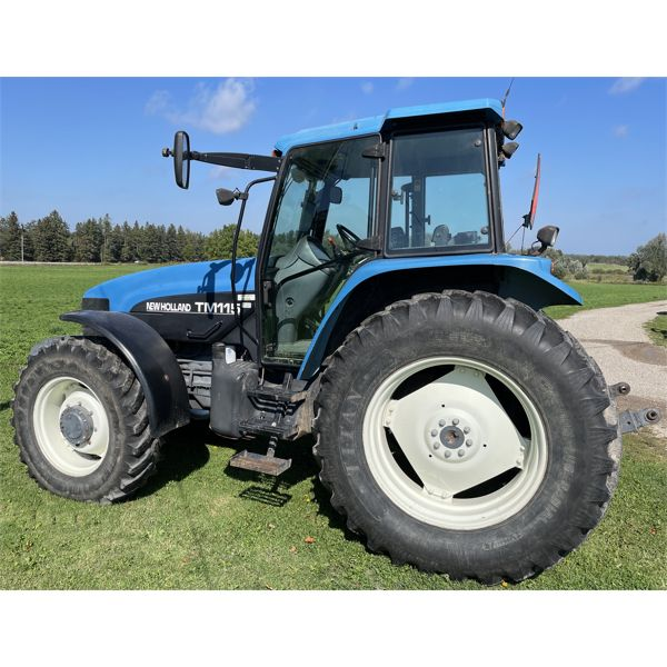 NEW HOLLAND MODEL TM115 TRACTOR WITH CAB